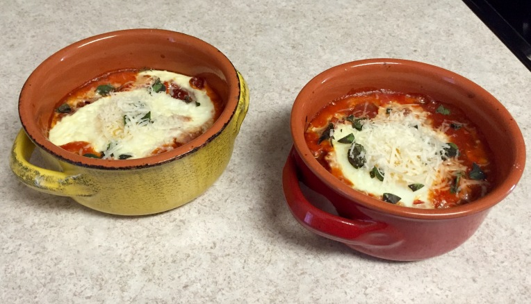 Egg & cannellini beans baked in roasted tomato pasta sauce & topped with fresh oregano & parmesan